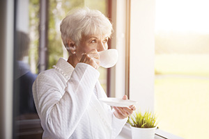 senior sipping coffee