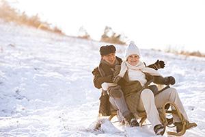 seniors sledding in winter